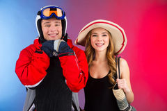 Close up of couple in different seasonal clothes. Stock Images