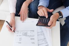 Close-up of couple doing finances at home Stock Photography