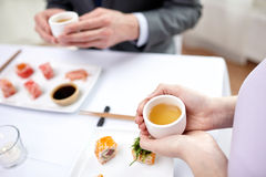 Close up of couple drinking tea at restaurant Stock Image