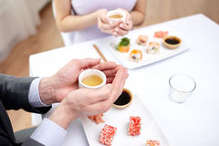 Close up of couple drinking tea at restaurant Royalty Free Stock Image