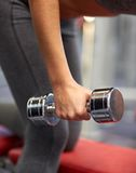 Close up of couple with dumbbell exercising in gym Royalty Free Stock Photo