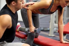 Close up of couple with dumbbell exercising in gym Stock Images