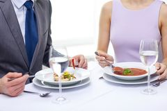 Close up of couple eating appetizers at restaurant Stock Photography