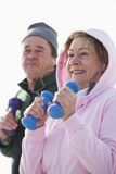 Close up of couple exercising with hand weights Stock Photography
