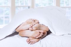 Close-up of couple feet cuddling 1 Royalty Free Stock Image