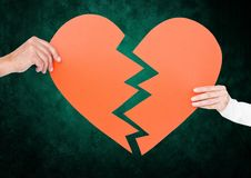 Close up of couple hands holding broken heart Stock Photos
