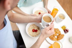 Close up of couple having breakfast at home Stock Images