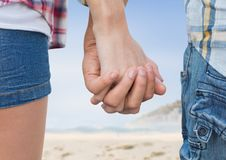 Close-up of couple holding hands. On beach Stock Photography