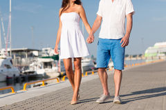Close up of couple holding hands and walking Stock Photos