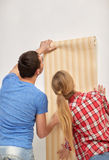 Close up of couple holding wallpaper Royalty Free Stock Photos