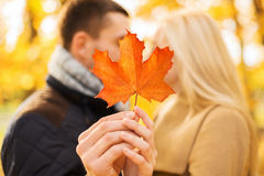Close up of couple kissing in autumn park Stock Photos