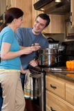 Close-up of couple in the kitchen - Vertical Royalty Free Stock Images