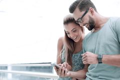 Close up.a couple in love discussing video on a smartphone stock photography