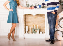Close up of couple in love holding hands near a fireplace Royalty Free Stock Photography