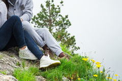 Close up, couple in love sitting on a mountain, hugging and look Stock Photos