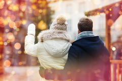 Close up of couple in old town at christmas Royalty Free Stock Image