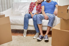 Close up of couple relaxing on sofa in new home Royalty Free Stock Photos