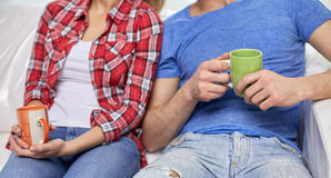Close up of couple relaxing on sofa in new home Royalty Free Stock Photo