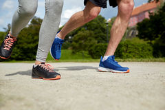 Close up of couple running outdoors Royalty Free Stock Photo