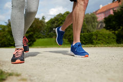 Close up of couple running outdoors Stock Photos