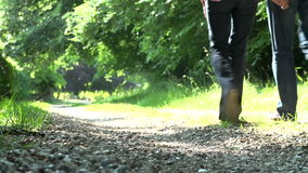 Close Up Of Couple's Feet Walking Along Countryside Path stock video footage