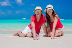 Close up of couple sitting in the heart on tropical white beach Stock Images