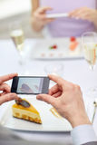 Close up of couple with smartphones at restaurant Stock Photo
