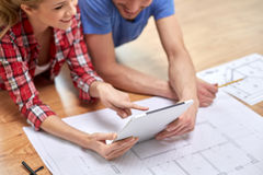 Close up of couple with tablet pc and blueprint Stock Images