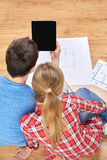 Close up of couple with tablet pc and blueprints Stock Photo