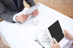 Close up of couple with tablet pc at restaurant Stock Photos