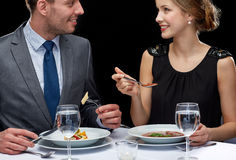 Close up of couple talking at restaurant Stock Photo