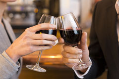 Close Up of Couple Toasting with red wine glass in restaurant Stock Photography