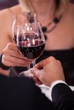 Close-up of couple toasting wine royalty free stock images