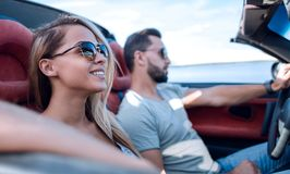 Close up.the couple traveling in a convertible royalty free stock photography