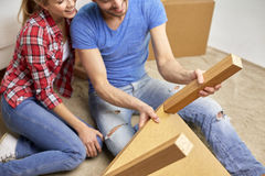 Close up of couple unpacking furniture and moving Stock Photo