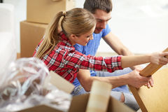 Close up of couple unpacking furniture and moving Royalty Free Stock Images