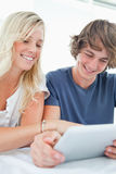 Close up of a couple using a tablet Stock Image