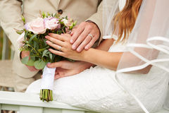 Close Up Of Couple At Wedding Holding Hands Stock Photography