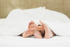 Close up of couples feet Stock Photography