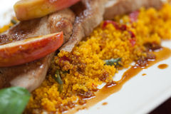 Close up of couscous with meat and apple Royalty Free Stock Photos