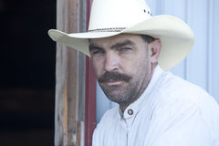 Close up of cowboy against a wall. Royalty Free Stock Photos