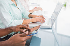 Close up of coworkers using laptop and tablet Stock Photo