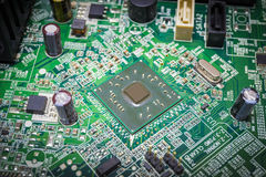 Close-up on a CPU microchip on a scheme in mainboard Royalty Free Stock Photo