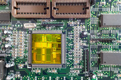 Close-up on a CPU microchip on a scheme. In mainboard is heart important computer or electronic circuits. Silicone crystall Royalty Free Stock Photos