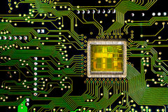 Close-up on a CPU microchip on a scheme. In mainboard is heart important computer or electronic circuits. Silicone crystall royalty free stock photo