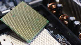 Close Up on CPU and relative Socket on PC Motherboard. Rotational 4K Video. stock video