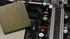 Close Up on CPU and relative Socket on PC Motherboard. Rotational 4K Video. stock footage