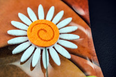 Craft Daisy Flower. Close-up craft felt daisy flower on stylish abstract type background Royalty Free Stock Photo