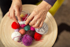 Close up of crafting hands with wool Royalty Free Stock Photos