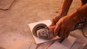 Close up of craftsman is cutting floor tile with stock video footage